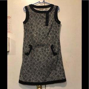 Kim Rogers black and white sleeveless dress